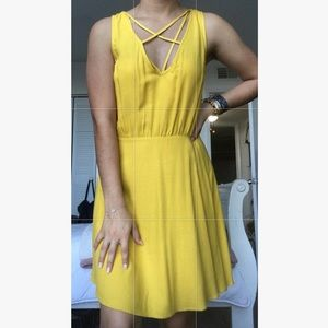 Yellow dress with a low front and open back